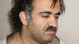 The security official said the documents, found at a house in the Pakistani city of Rawalpindi where authorities say Khalid Sheikh Mohammed, shown in the photograph during his arrest on March 1, 2003, provided an important insight into the al Qaeda network. Documents suggest Osama bin Laden is alive and that they were in recent contact, a senior Pakistani security official said Thursday. (Editors, U.S.News & World Report obtained this exclusive alternate photo from the arrest of Khalid Sheikh Mohammed.) Mandatory credit REUTERS/Courtesy U.S.News & World Report  HK/jm