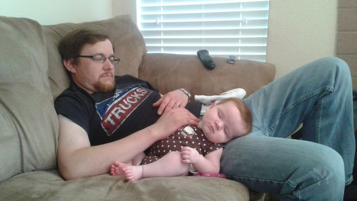 Christopher and his daughter; photo courtesy of Selby Jansky