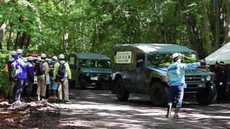 Self-Defense Forces vehicles are heading to search for a missing boy in Nanae on Japan's main northern island of Hokkaido, on June 1, 2016.  Japan's military on June 1 joined the difficult search for a seven-year-old boy missing since his parents abandoned him in a bear-inhabited forest, officials said. / AFP / JIJI PRESS / JIJI PRESS / Japan OUT        (Photo credit should read JIJI PRESS/AFP/Getty Images)