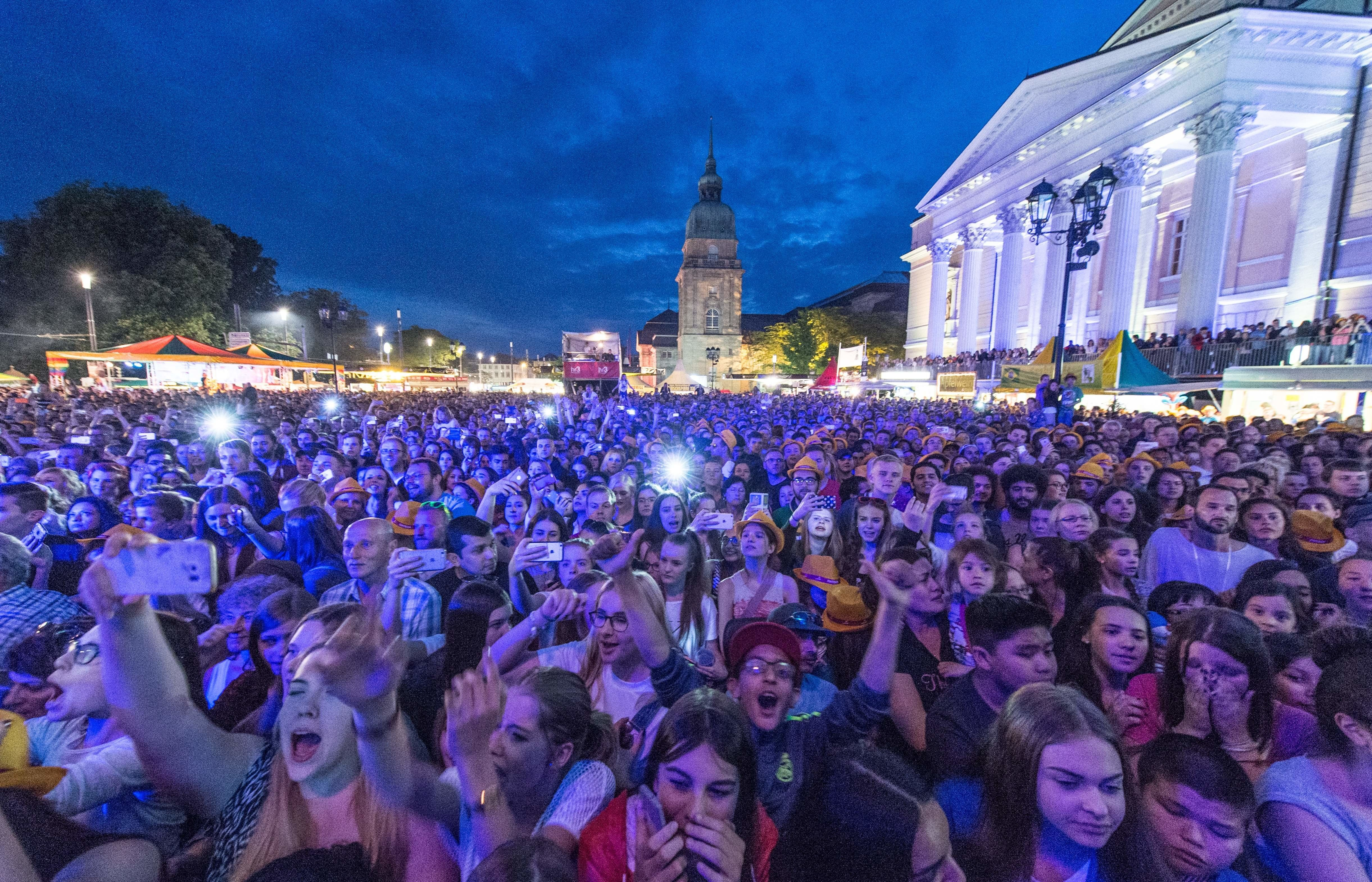 German police arrested three menafter dozens ofwomen made complaints of sexual assaults at the Schlossgrabenfest