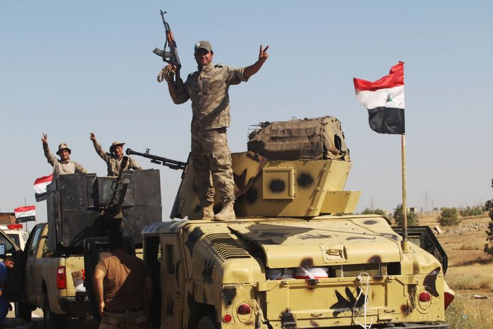 With 50,000 civilians still believed trapped inside Fallujah, the United Nations has warned that militants are holding hundreds of families in the center as human shields.