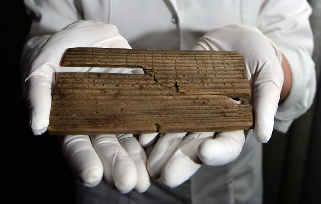 Apiece of wood with the Roman alphabet written on it in AD
