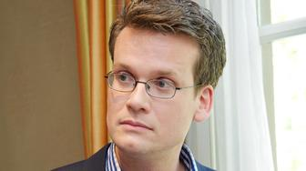 BEVERLY HILLS, CA - APRIL 14:  Novelist John Green at 'The Fault In Our Stars' Press Conference at the Four Seasons Hotel on April 14, 2014 in Beverly Hills, California.  (Photo by Vera Anderson/WireImage)