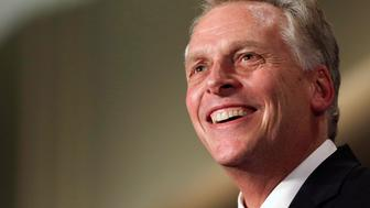 Virginia Democratic governor-elect Terry McAuliffe smiles during his election night victory rally in Tyson's Corner, Virginia November 5, 2013. McAuliffe defeated Republican candidate Ken Cuccinelli in today's governor's election in Virginia. REUTERS/Gary Cameron    (UNITED STATES - Tags: POLITICS ELECTIONS)
