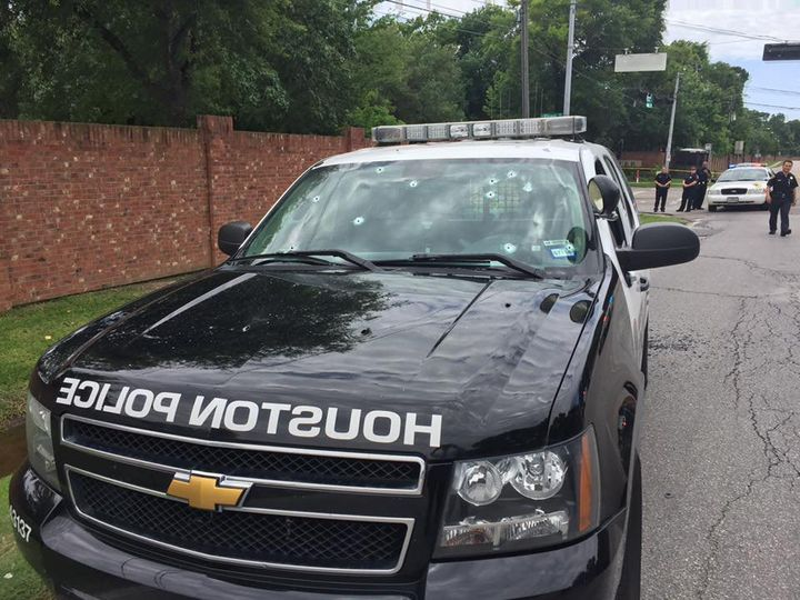 Bullet holes in the windshield of a Houston Police Department patrol car on May 29, 2016. The shootingleft two people d