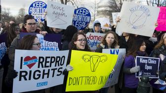 Supporters of legal access to abortion rally outside the Supreme Court in Washington, DC, March 2, 2016, as the Court hears oral arguments in the case of Whole Woman's Health v. Hellerstedt, which deals with access to abortion. / AFP / SAUL LOEB        (Photo credit should read SAUL LOEB/AFP/Getty Images)