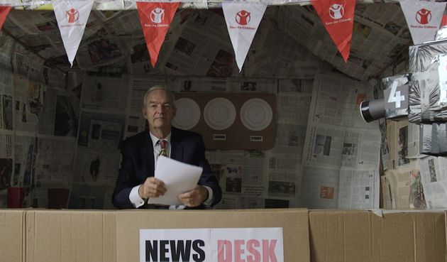 Snow presented the 'news' from a studio made by the
