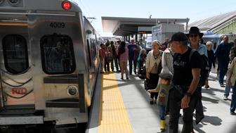 DENVER, CO - April 22: Train passengers arrive at Denver International after taking a trip on the RTD University of Colorado A Line train at Denver International Airport April 22, 2016. (Photo by Andy Cross/The Denver Post via Getty Images)