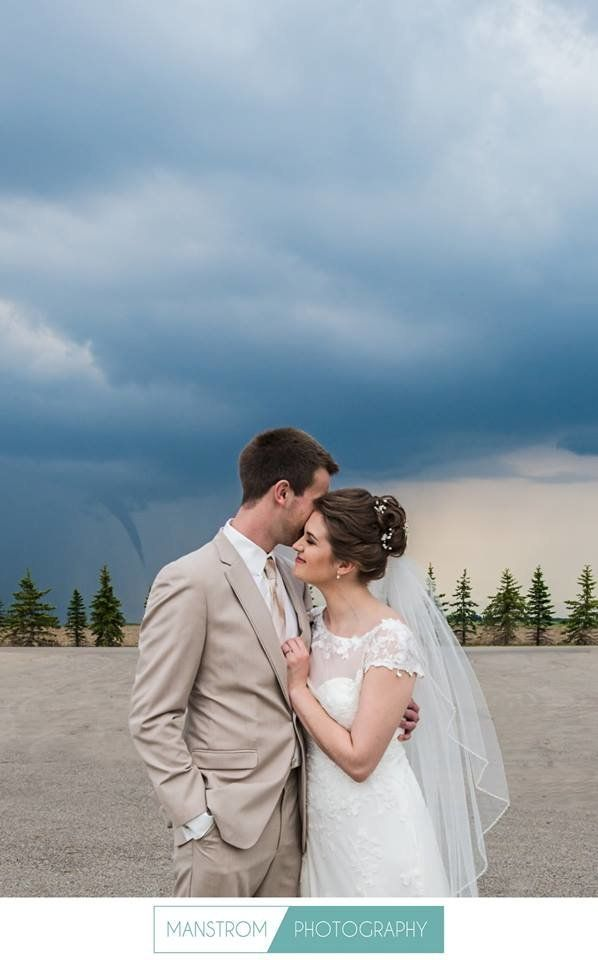 A funnel cloud photobombed a bride and groom before their ceremony near Moorhead, Minnesota.