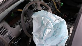 MEDLEY, FL - MAY 22:  A deployed airbag is seen in a 2001 Honda Accord at the LKQ Pick Your Part salvage yard on May 22, 2015 in Medley, Florida. The largest automotive recall in history centers around the defective Takata Corp. air bags that are found in millions of vehicles that are manufactured by BMW, Chrysler, Daimler Trucks, Ford, General Motors, Honda, Mazda, Mitsubishi, Nissan, Subaru and Toyota.  (Photo by Joe Raedle/Getty Images)