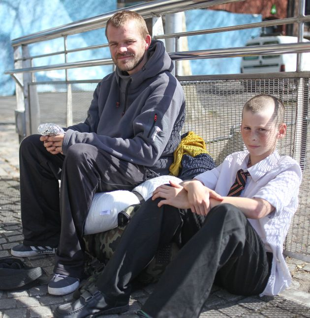 Wain Howell, who is homeless, sits with Hamish
