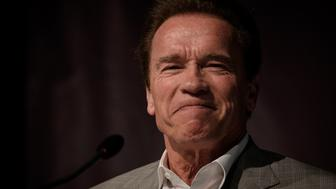 US actor and former California governor Arnold Schwarzenegger during a press conference to present the multisport event 'Arnold Classic Brasil 2016' in Rio de Janeiro on April 1, 2016.  AFP PHOTO / YASUYOSHI CHIBA / AFP / YASUYOSHI CHIBA        (Photo credit should read YASUYOSHI CHIBA/AFP/Getty Images)