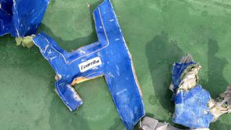FILE PHOTO: Recovered debris of the EgyptAir jet that crashed in the Mediterranean Sea is seen in this handout image released May 21, 2016 by Egypt's military. Egyptian Military/Handout via Reuters/File photo      ATTENTION EDITORS - THIS IMAGE WAS PROVIDED BY A THIRD PARTY. EDITORIAL USE ONLY. NO RESALES. NO ARCHIVE. THIS PICTURE WAS PROCESSED BY REUTERS TO ENHANCE QUALITY. AN UNPROCESSED VERSION HAS BEEN PROVIDED SEPARATELY.     TPX IMAGES OF THE DAY