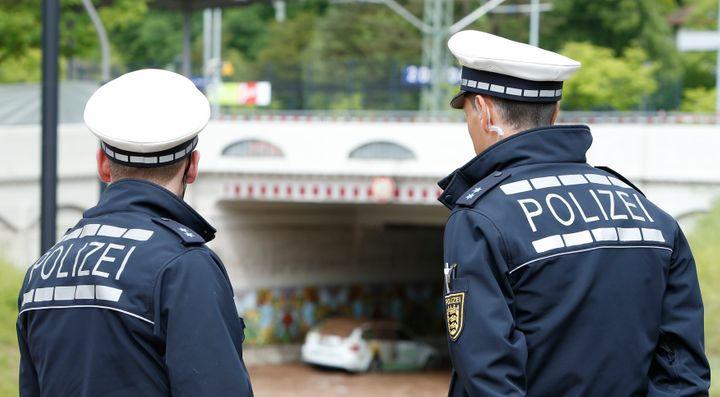 German police officers at the local train station after floods near Stuttgart, Germany, May 30, 2016. Authorities arrested th