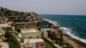 The La Perla shanty town, foreground, is seen in the Old City of San Juan, Puerto Rico, on Wednesday, July 8, 2015. A growing number of Republicans in the U.S. Congress are saying they want to support Puerto Rico as it wrestles with an escalating debt crisis, though they've stopped short of backing legislation allowing for municipal bankruptcy. Photographer: Christopher Gregory/Bloomberg via Getty Images