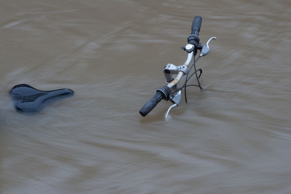 An abandoned bicycle was found along a Seine embankment.