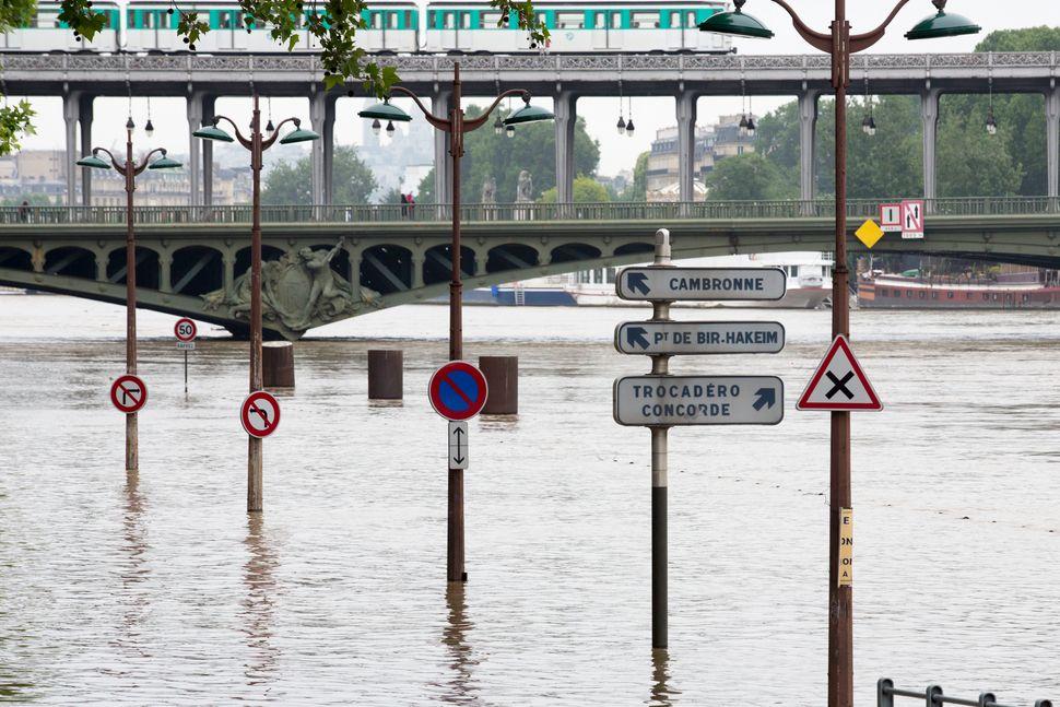 Street signs near the Bir Hakeim bridgeare almost totally submerged.