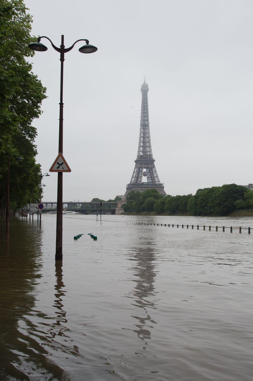 Water rises on roads near the Eiffel Tower.