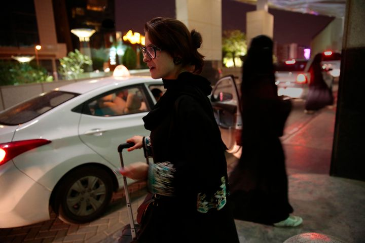 A woman waits for an Uber at a shopping mall in Riyadh, Saudi Arabia. Since women are not allowed to drive in the country, th