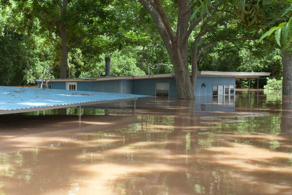 A house is seen flooded by water from the rain-swollen Brazos River in Richmond, Texas, on Tuesday.
