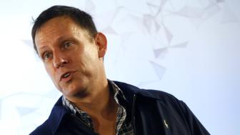 Peter Thiel, the Silicon Valley investor who co-founded PayPal, talks to students during his  visit to the 42 school campus in Paris, France, February 24, 2016. REUTERS/Jacky Naegelen