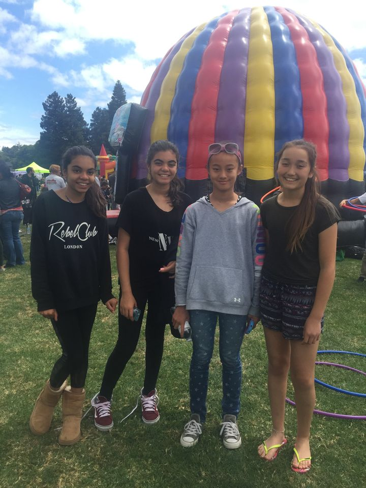 Zara, left, with her sister and friends at the Hometown Days fairin San Carlos, California, on May 22, 2016.