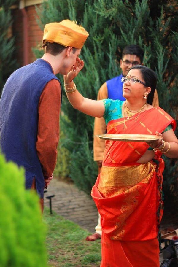 Salaphaty's mother (Simsalaram) removing the evil eye by waving a camphor flame (Dhrishti).
