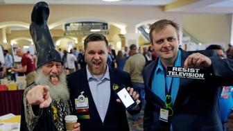 Libertarian Party candidate Vermin Supreme (L), wears his signature boot, with supporters at the National Convention held at the Rosen Center in Orlando, Florida, May 29, 2016.  REUTERS/Kevin Kolczynski     TPX IMAGES OF THE DAY