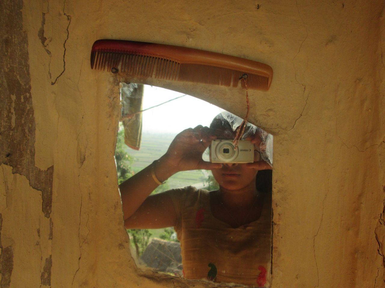 In some regions, when girls get their first period, they're not allowed to look into mirrors or comb their hair.