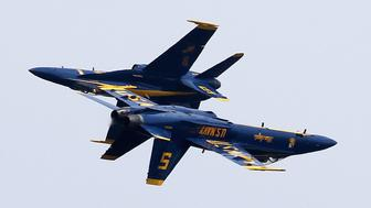 ANNAPOLIS, MD - MAY 25:  The US Navy Blue Angels perform maneuvers over the US Naval Academy May 25, 2016 in Annapolis, Maryland. Once a year the Blue Angels put on a show over the Academy during commission week, and will do a flyover during graduation ceremonies on Friday.  (Photo by Mark Wilson/Getty Images)