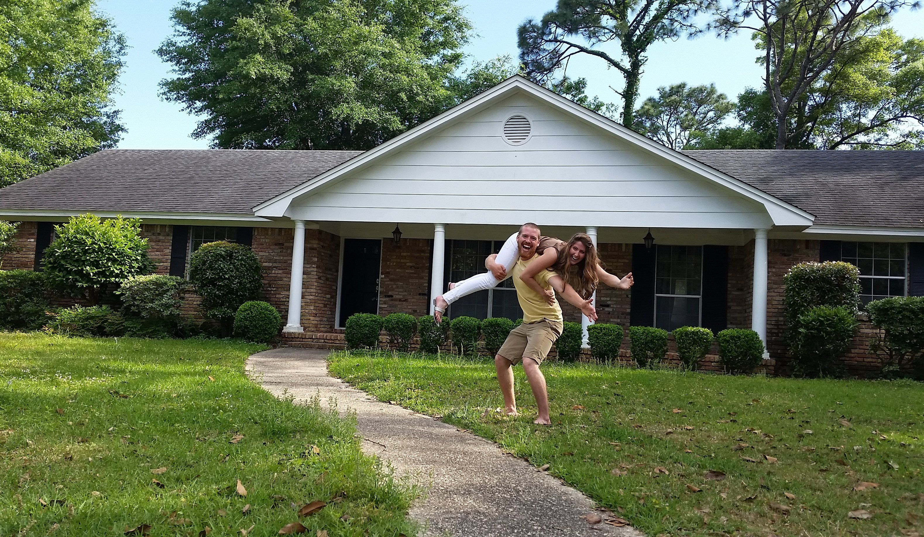 Zac and Shannon Carter, who have been married for two years, pose in front of their newly purchased home in Pensacola, Florida.