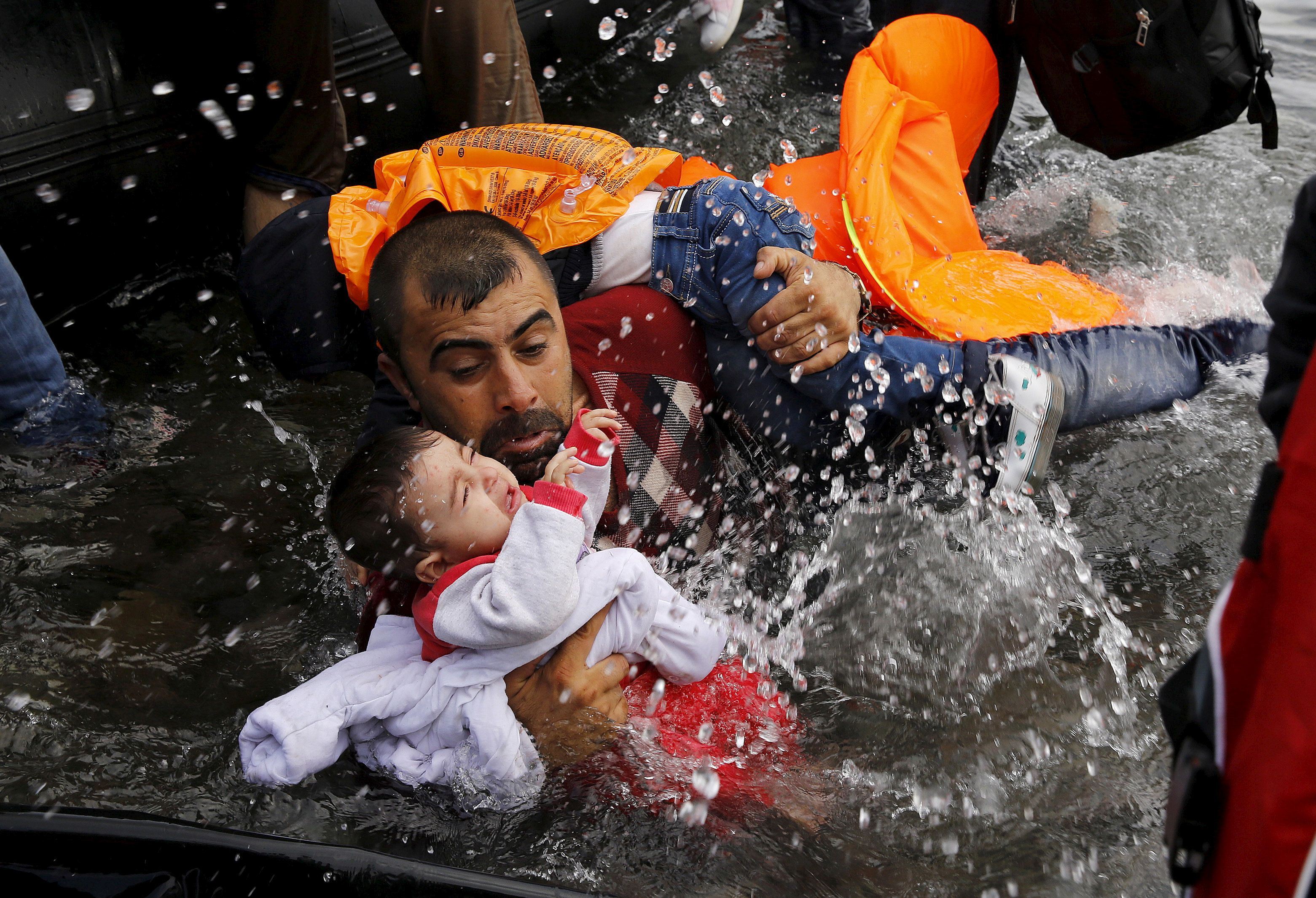 Image result for refugee father with child in water