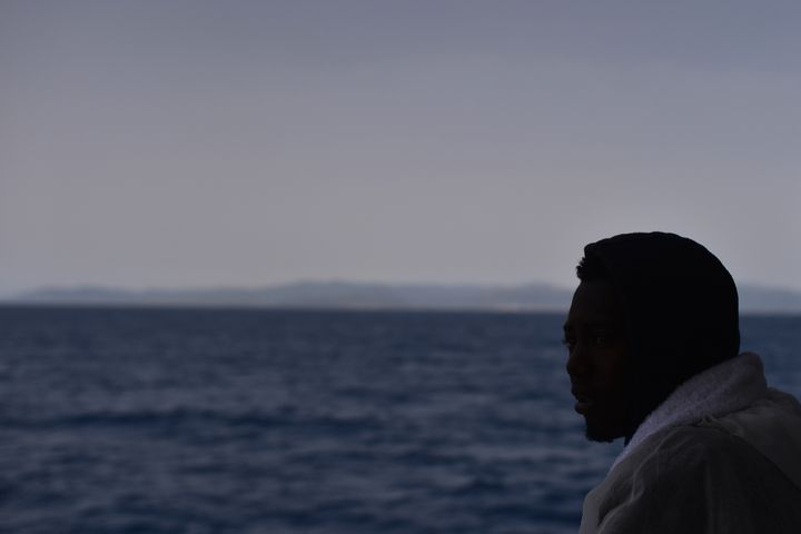 Hundreds of migrants were rescued from a sinking ship on Friday. Four bodies were also recovered.