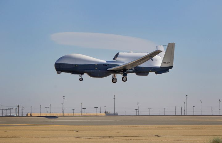 """The Triton unmanned aircraft system completes&nbsp;its first flight from the Northrop Grumman manufacturing facility in Palmdale, California, in 2013. The Triton is designed for <a href=""""https://www.wired.com/2014/01/triton/"""" target=""""_blank"""">surveillance</a>, not killing."""