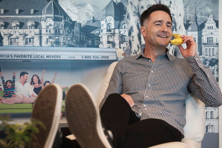Brian Scudamore, CEO of O2e Brands on his banana phone at work.
