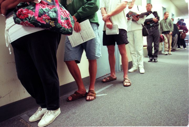 Applicants for food stamps line up in the hallway while they wait for their appointments with a counselor at the Dept of Soci
