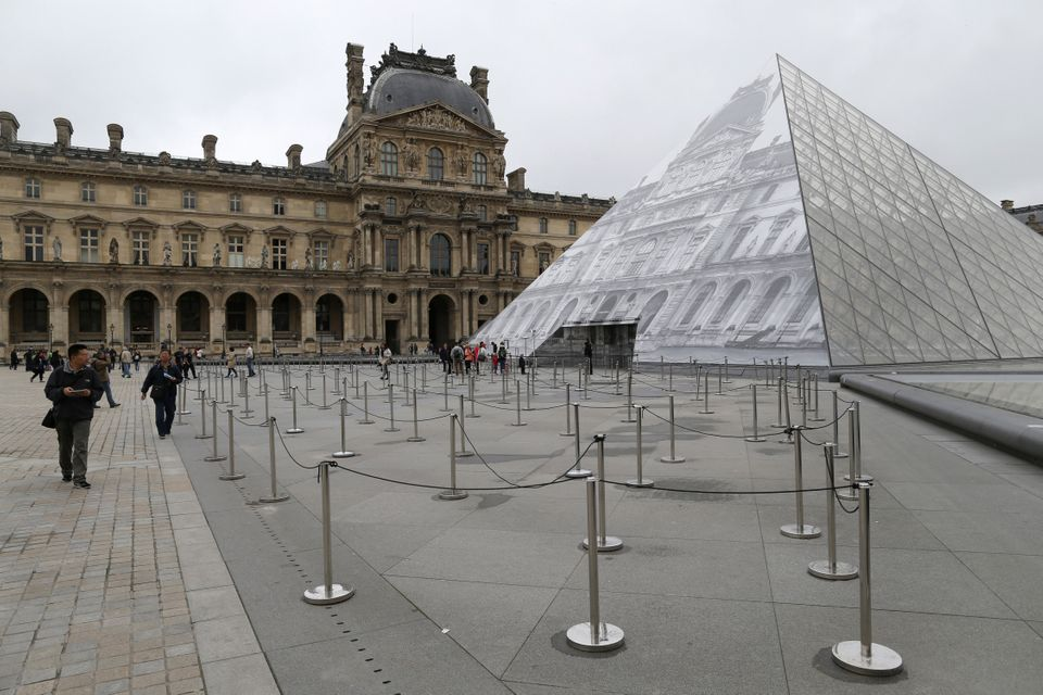 The Louvre looked eerily quiet as tourists were turned