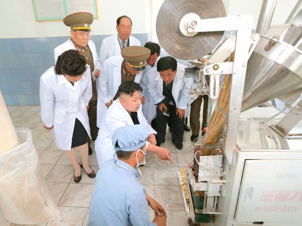 North Korean leader Kim Jong Un visits a foodstuff processing factory under the Korean People's Army Unit 534 in May of