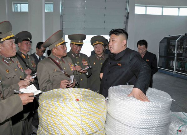 North Korean leader Kim Jong Un visits the Seong-cheon River Fishnet Factory and Plastic Factory in June of 2013.