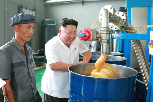 North Korean leader Kim Jong Un smiles during a visit to the Chonji Lubricant Factory in August of 2014.