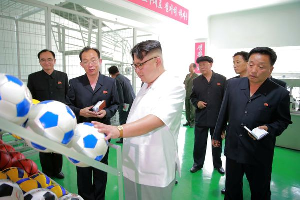 Inspecting at a newly built sports goods factory in Pyongyang in June of 2016.