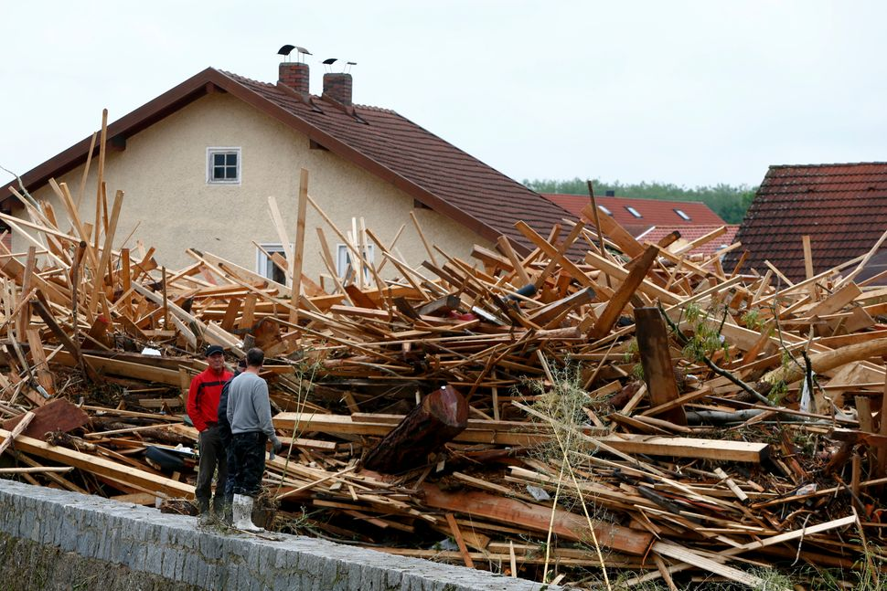Residents look at debris caused by floods in the Bavarian village of Simbach am Inn, Germany, on June 2, 2016.