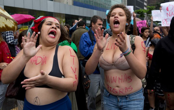 "Women chant slogans during the ""Slutwalk,"" a protest march against sexual harassment, in Sao Paulo, Brazil, on May 24, 2014."