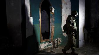 A Russian soldier, who escorted a group of journalists, walks inside a Greek Orthodox church in village of Maaloula on March 3, 2016.