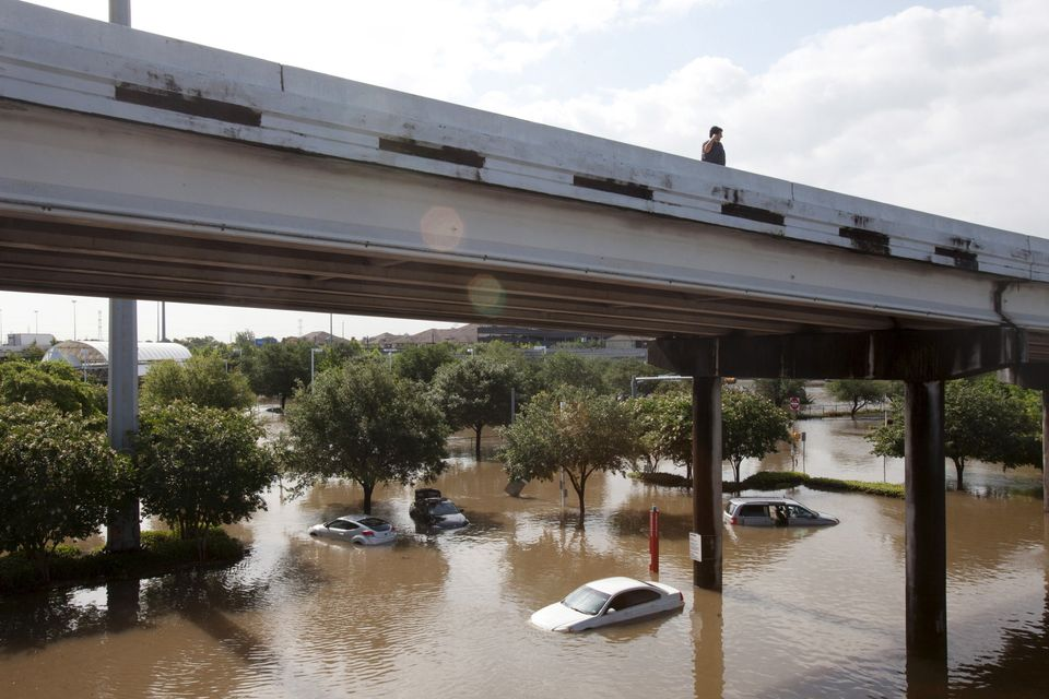 Motorists survey the floodwaters in southwest Houston on May 26,