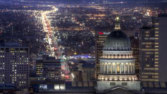 View of Salt Lake City, Utah, with Utah State Capitol in the foreground, at dusk
