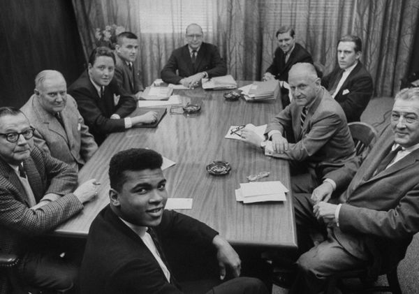 Muhammad Ali with promoters.