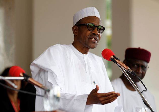 Nigerian President Muhammadu Buhari speaks at a joint news conference with his French counterpart Francois...