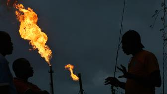 Gas flares burn from pipes at an oil flow station operated by Nigerian Agip Oil Co. Ltd. (NAOC), a division of Eni SpA, in Idu, Rivers State, Nigeria, on Monday, Sept. 28, 2015. Nigeria's daily output of about 2 million barrels of oil makes it Africa's largest producer. Photographer: George Osodi/Bloomberg via Getty Images