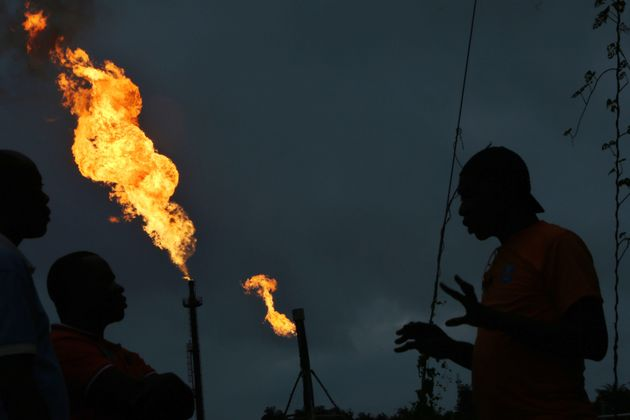 Gas flares burn from pipes at an oil flow station operated by Nigerian Agip Oil Co. Ltd., a division...